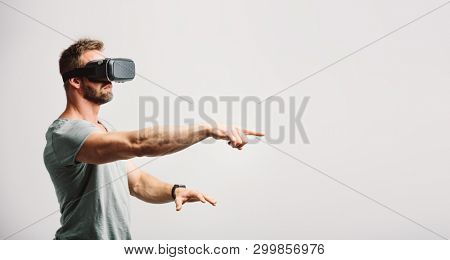 Man using vr headset clicking with finger. Modern technology, virtual reality fun