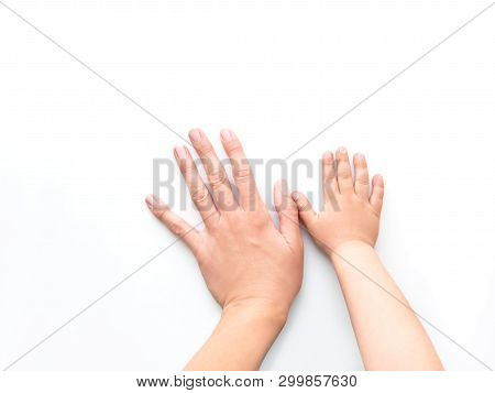 Hands Of Adult And Child. Mother And Kid Put Their Palms Together On White Background. Parent And To