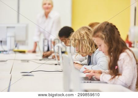 Pupils in a computer class of a primary school learn with fast internet