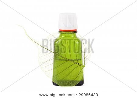Organic oil with leaf close up on the white isolated background