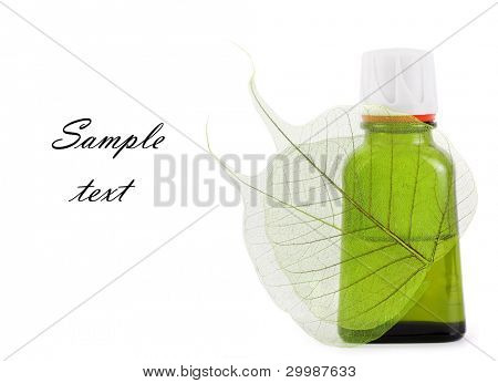 Organic oil with leaf close up on the white isolated background(With sample text)