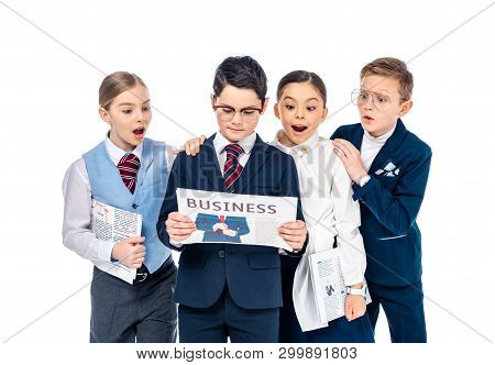 surprised schoolchildren pretending to be businesspeople reading newspaper Isolated On White poster