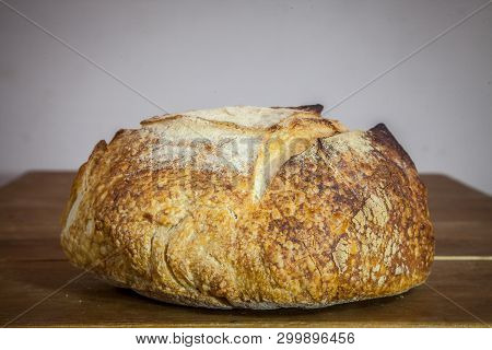 Loafs (or Miche) Of French Sourdough, Called As Well As Pain De Campagne, On Display On A Wooden Tab