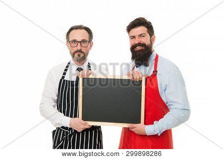 Men Bearded Bartender Or Cook In Apron Hold Blank Chalkboard. Bartender With Blackboard. Hipster Bar