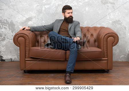 Elegant And Confident. Man Of Fashion. Fashion Model Relaxing On Sofa. Bearded Man Enjoying Casual F