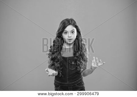 What Are You Talking About. Kid Stunned Bewildered Emotion Can Not Believe Her Eyes. Girl Curly Hair