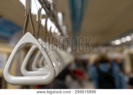 Hold on to the handrail in the train. poster