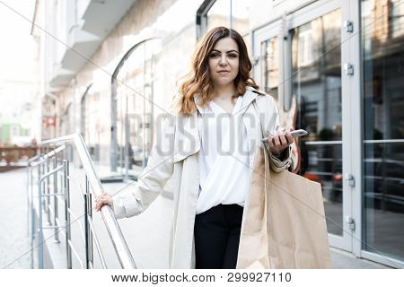 A Young, Sympathetic Woman, Not A Thin-headed Body Building, Walks Around The City With A Shopping B