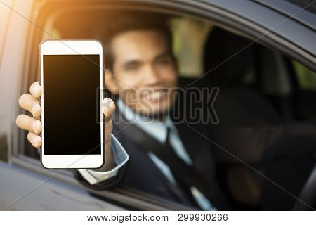 Man Holding Mobile Smart Phone In Car