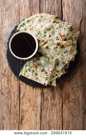 Vegan Scallion Pancakes Are A Crispy Pan-fried Chinese Flatbread Close-up On A Board. Vertical Top V