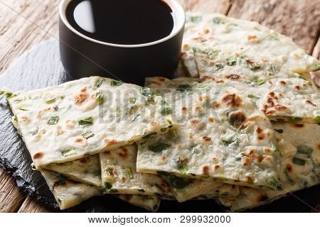 Chinese Scallions Pancake Also Known As Green Onion Pancake Or Congyoubing  Close-up On A Board. Hor