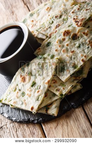 Vegan Scallion Pancakes Are A Crispy Pan-fried Chinese Flatbread Close-up On A Board. Vertical