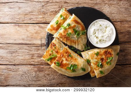 Bolani Flat-bread From Afghanistan, Baked Or Fried With A Vegetable Filling And Served With Plain Yo