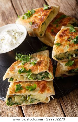 Bolani Is A Traditional Afghani Flatbread Stuffed And Baked With Either Potato, Onion, Cilantro Fill