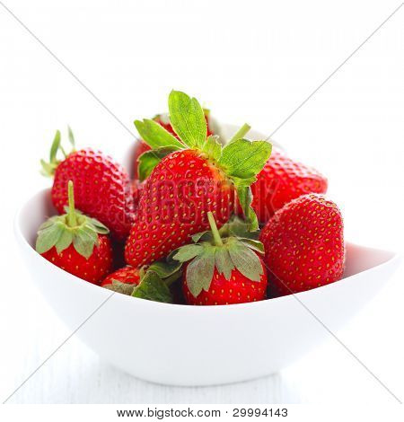 Fresh strawberries in bowl isolated on white background