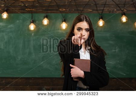 Student Life. Young Attractive Teacher Pointing At Chalkboard. Teenager School. Teenager School - Fi