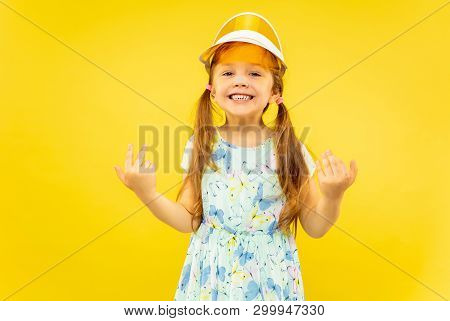 Beautiful Emotional Little Girl Isolated On Yellow Background. Half-lenght Portrait Of Happy And Cel