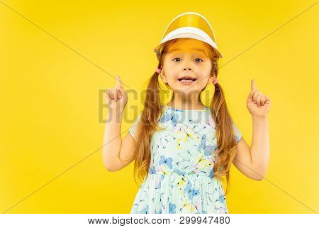 Beautiful Emotional Little Girl Isolated On Yellow Background. Half-lenght Portrait Of Happy Child W