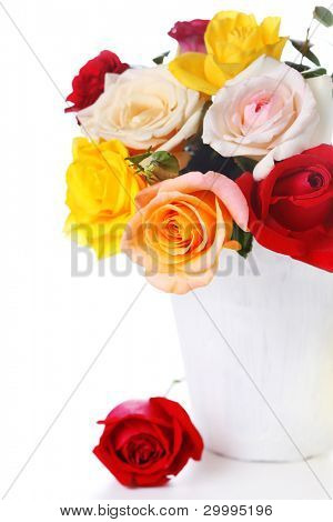 Bouquet roses in vase on white isolated background