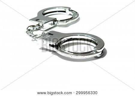 Plastic Hand Cuffs. Fun Cuffs. Isolated on white. Room for text. Funny and  Funky Fashion.