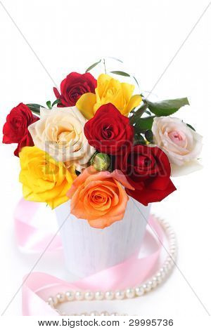 bouquet of roses in vase on white isolated background