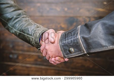 Partnership And Business Deal. Successful Deal Handshake. Handshake Approving Sign. Agreement Compro