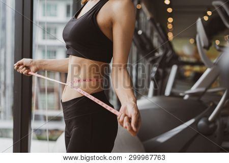Closeup Woman Slim Athlete Using Body Fat Measurement And Waist Size With Waist Line After Workout A