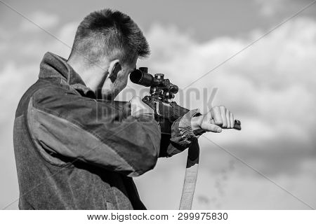 Hunting Optics Equipment For Professionals. Brutal Masculine Hobby. Man Aiming Target Nature Backgro