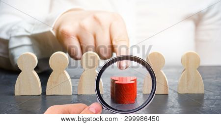 Woman Leader Dismisses The Employee From The Team. Female Hand Pushes A Red Man. Personnel Managemen