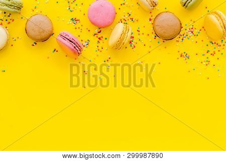 Sweet Dessert Pattern With Macarons On Yellow Background Flat Lay Mockup