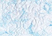 Crumpled toned paper. Blue color, folds, fissure, fracture. Ice, snow imitation. Hand drawn textured background. poster