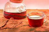 cup and teapot with tea on sand beach or wilderness, close up. Thirst to drink in wilderness. poster