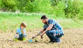 rich natural soil. Eco farm. happy earth day. Family tree. new life. soils and fertilizers. small boy child help father in farming. father and son planting flowers in ground. earth day. Garden bed poster