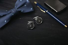 Luxury Cufflinks On The Black Background. Gentlemen Accessories.