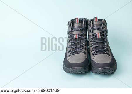 Front View Of A Pair Of Mens Shoes On A Blue Background. Mens Shoes For Cold Weather. Casual Sports