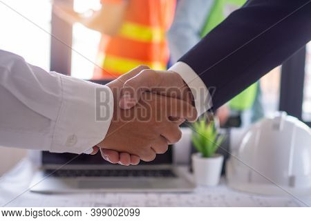 The Construction Team Leader Is Going To Shake Hands With The Leader Engineer, Start The Constructio