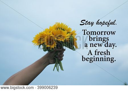 Inspirational Quote - Stay Hopeful. Tomorrow Brings A New Day. A Fresh Beginning.  With Hand Holding