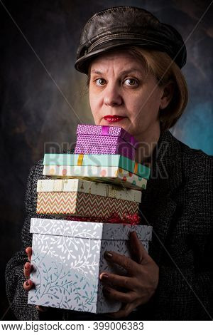 A Man Accepts A Long-awaited Gift In A Beautiful Package. A Cardboard Box With A Surprise Inside.