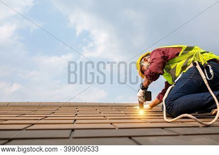 Roof Repair, Construction Worker Install Roof, Roofing Tools,electric Drill Used Replacement Of Roof