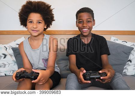 Portrait Of Two Afro American Brothers Playing