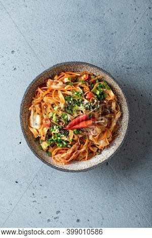 Asian Food, Wok Noodle And Vegetables In Ceramic Bowl, Top View
