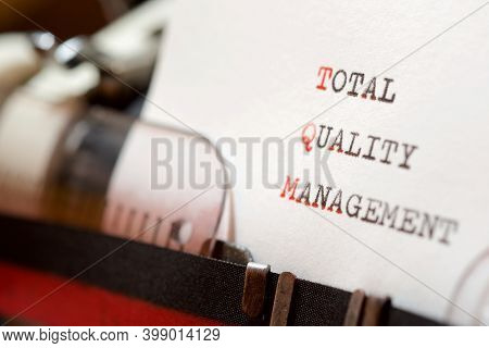 Total quality management phrase written with a typewriter.