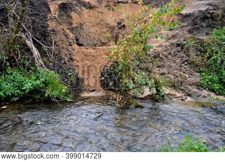 Deep Excavation Flooded By Water When The Pipeline Failed. Mining Of Sand, Gold By The Stream, Panni