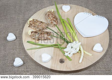 Flowers Made Of Meat On Wooden Cutting Board And Natural Burlap Background. Food Art Idea For Valent