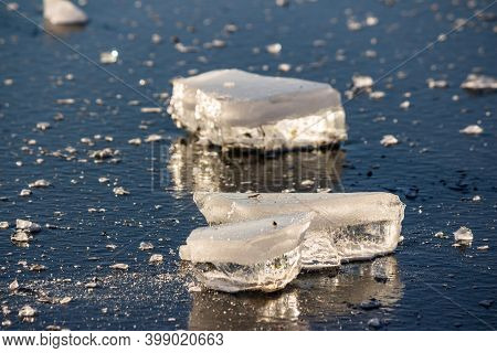 Pieces Of Pure Ice On The Pond