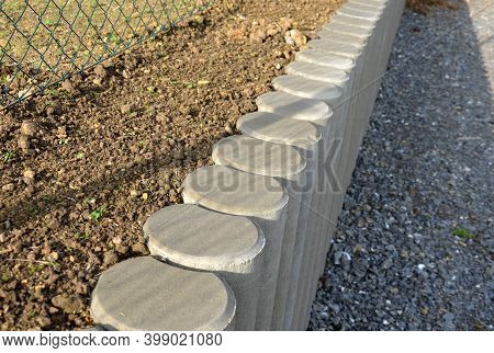 Palisade Made Of Concrete Of Various Shapes And Profiles Is Widely Used Especially In Garden Archite