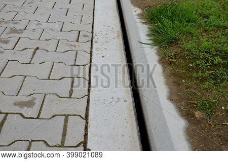 Slotted Pipes Drain Rainwater And Oil Substances, Drips From Paved Surfaces. Concrete Products At Th