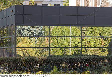 Reflection Of The Surrounding Landscape In The Mirrored Windows Of The Adjoining Pavilion. The Refle