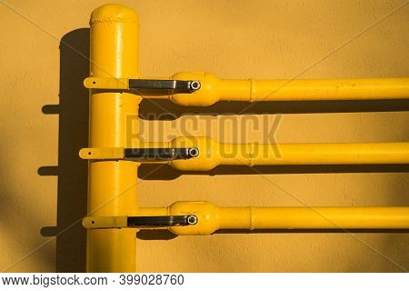 Yellow Gas Pipe With A Crane And Gear.
