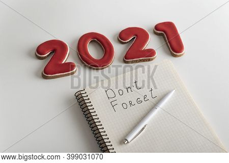 Numbers 2021 And Notebook With Inscription Dont Forget. Wish List And Goals For 2021